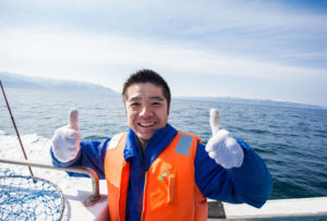 hokkaido fishing thumbs-up smile sea